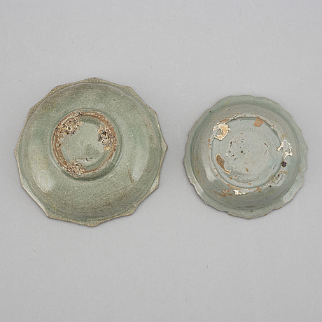 Two celadon glazed dishes, south east asia, 17th/18th century.