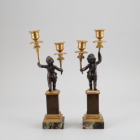 A pair of bronze empire style candleabra, 20th century.