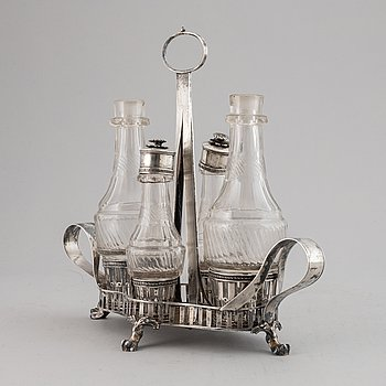 A swedish silver and glass cruet stand.