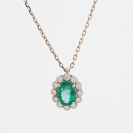 An 18k gold necklace set with a faceted emerald ca 1.10 ct.