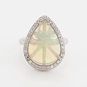 Drop shaped opal and brilliant-cut diamond cocktail ring.