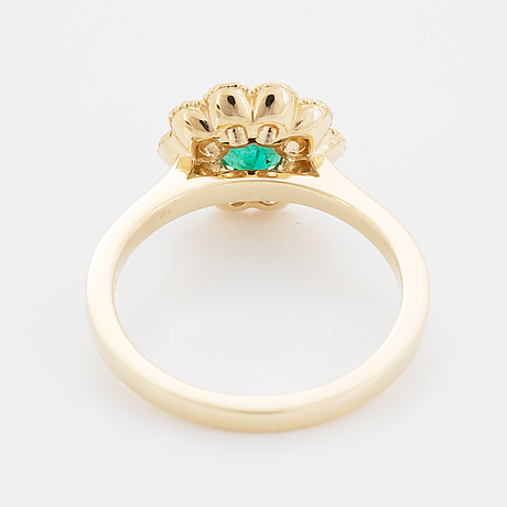 A 14k gold ring set with a faceted emerald.