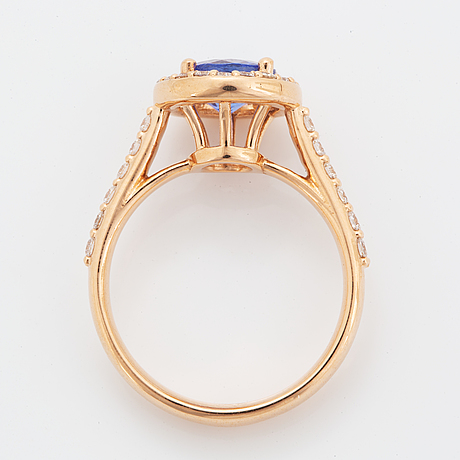 An 18k gold ring set with a faceted tanzanite.
