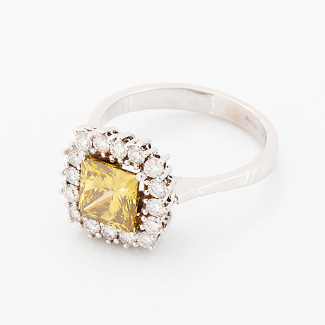 Princess-cut colour treated fancy deep brown-yellow diamond ring.