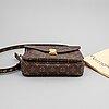 Louis vuitton, a 'pochette métis' monogram canvas bag.