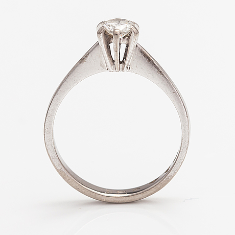 An 18k white gold ring with a diamond ca. 0.25 ct. import marked tillander, helsinki 1975.