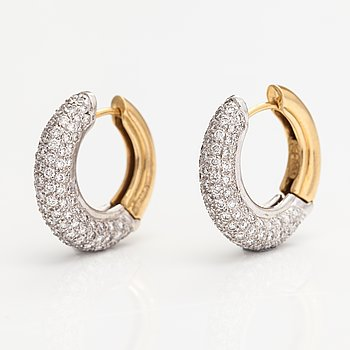 A pair of 28K gold earrings with diamonds ca 1.10 ct in total. Import marked A Tillander, Helsinki 1996.