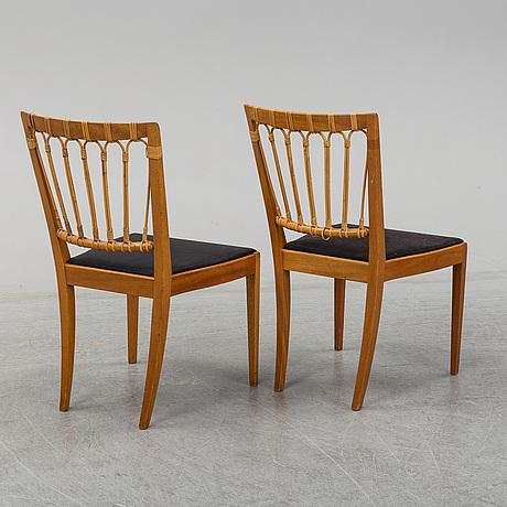 A pair of mahogany and rattan dining chairs, josef frank, , model 1165, svenskt tenn, stockholm.