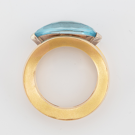 18k gold and navette shaped blue topaz.