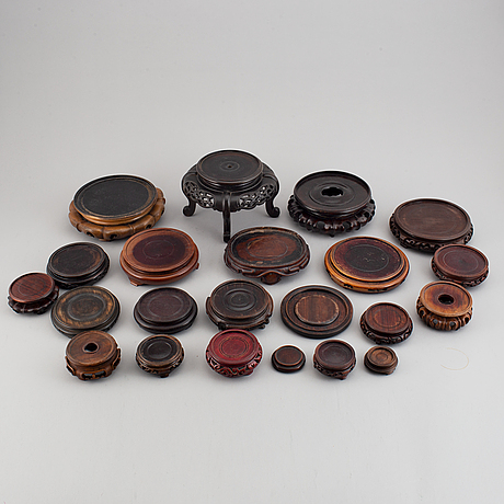 A group of 22 chinese wooden stands, 20th century.