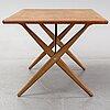 Hans j wegner, a teak 'savbukkebordet at-303' dining table, andreas tuck, denmark.