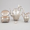 A swedish silver coffee pot, creamer sugar box and sugar tongs, mark of samuel pettersson, linköping 1900.