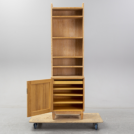 An oak bookcase with cabinet, mid 20th century.
