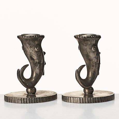 Carl milles, a pair of pewter candlesticks and inkwell, herman bergman, 1930, the model exhibited at the stockholm exhibition.