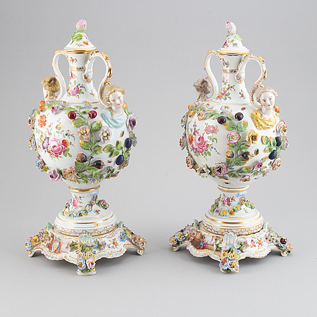 A pair of enamelled earthenware vases with covers, 20th century.