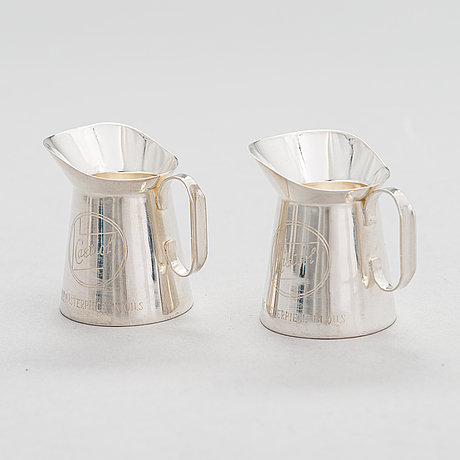 A 1950s 3-piece silver drinking set, 'castrol motor oil' design. maker's mark of veikko reinikka, helsinki 1957.