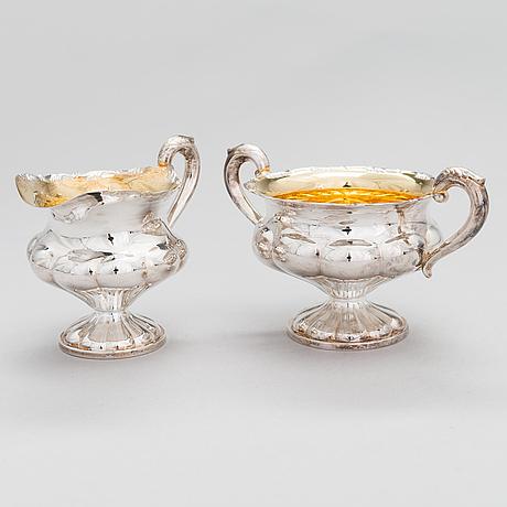 A silver coffee pot, a parcel-gilt sugar bowl and cream jug, turku finland 1946 and 1985.