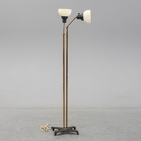 A 1950s brass and glass floor lamp.