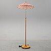 A 1940s birch wood floor lamp.