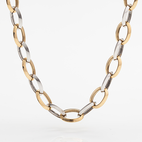 A 14k white and yellow gold necklace.