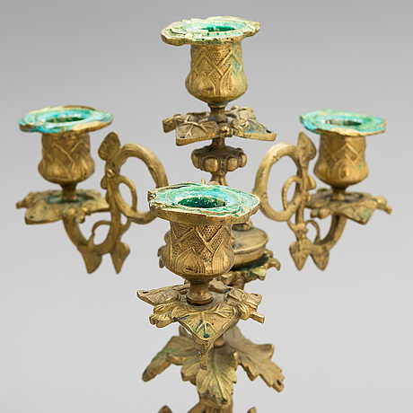A pair of bronze candelabra from the latter half of the 19th century.