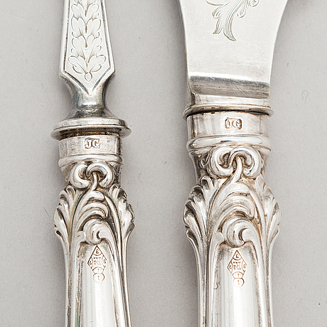 A pair of english silver-plated fish servers, maker's mark of john gilbert, latter half of the 19th century.