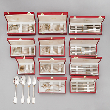 Cartier, a 79-piece silver-plated 'venitienne' cutlery set.