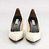 A pair of balenciaga beige suede shoes size 38.