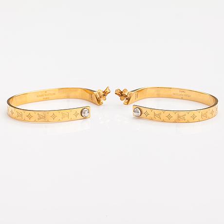 "Louis vuitton, a pair of ""nanogram hoop"" earrings. marked louis vuitton paris, italy."