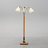 An elm floor light, mid 20th century.