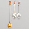 A 21-pcs set of finland's lion motif spoons in silver and enamel, turku 1938,1960 and 1966.