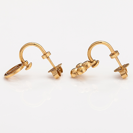 """Louis vuitton, a pair of """"blooming"""" earrings. marked lv."""