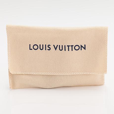 "Louis vuitton, a ""keep it twice monogram"" bracelet. marked lv, made in spain."