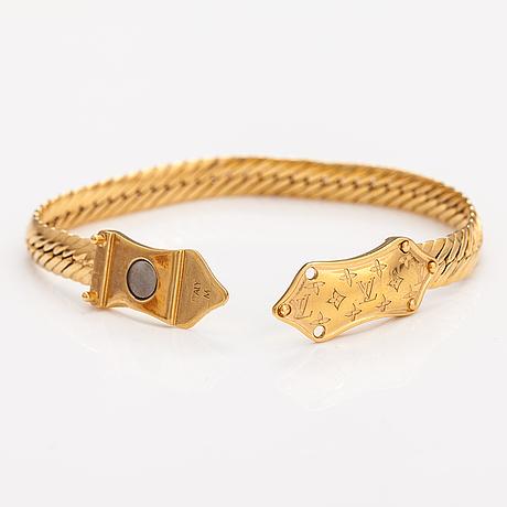 """Louis vuitton, """"nanogram"""" bracelet. marked louis vuitton paris, italy."""