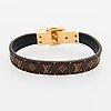 "Louis vuitton, ""fasten your lv"" bracelet. marked louis vuitton paris, made in spain."