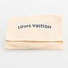 """Louis vuitton, """"confidential"""" bracelet. marked made in spain."""