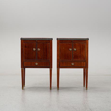 A pair of mahgany veneered bedside cabinets, early 20th century.