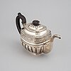 A russian 19th century parcel-gilt silver tea-pot, mark of anton christian iwersen, st. petersburg 1828.