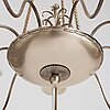 Swedish grace, a silver plated ceiling lamp for nine lights, 1920's.