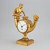 A 19th century empire mantle clock.