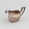 A silver coffee pot, creamer and sugar bowl, ag dufva, stockholm 1914.