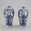 A pair of blue and white vases, qing dynasty, late 19th century, with a kangxi mark to the base.