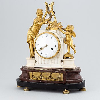A 19th-century Louis XVI-style mantle clock.