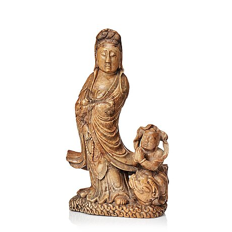 A soapstone sculpture of guanyin with an attendant, qing dynasty.