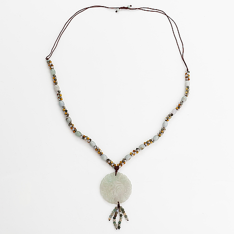 A collier with jade and nyon cord.