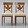 A pair of royal empire chairs, first half of the 19th century.