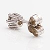 One 14k white gold earring with a ca. 0.20 ct diamond.