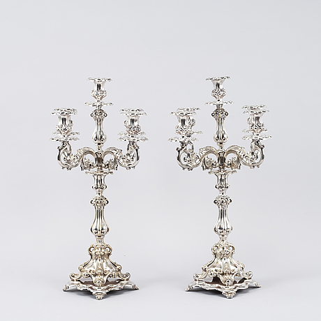 A pair of silver plated five light candelabras, neo rococo.