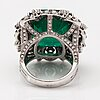 A cocktail ring made of 18k white gold with an ca 20.37 ct emerald and rose- and brilliant-cut diamonds ca. 2.72 ct.