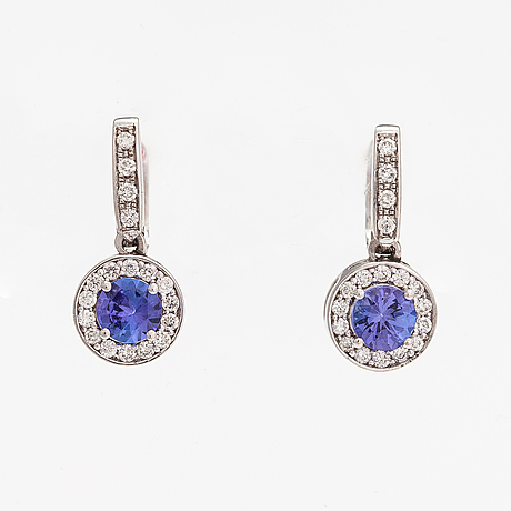 A pair of 18k white gold earrings with tanzanites ca 0.94 ct in total and diamonds ca. 0..38 ct in total.